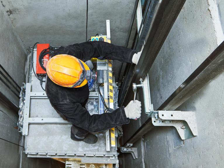Repairing elevator in shaft